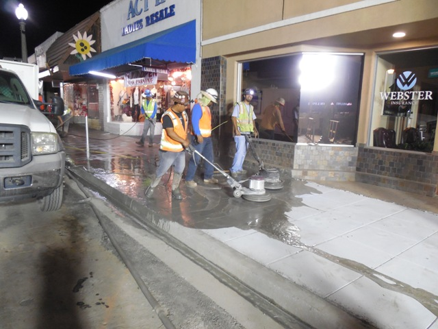 091714 Buffing sidewalk for finish.jpg